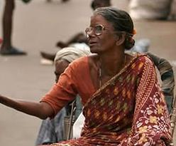 A beggar with donated glasses